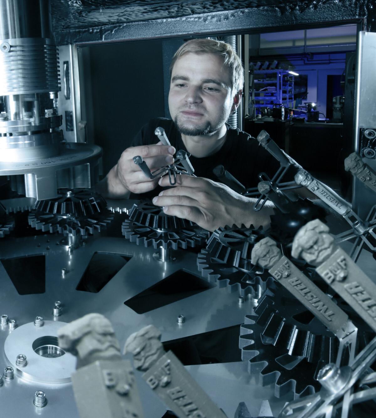 Industrial equipment engineer working on parts