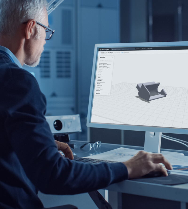 Engineer looking at Markforged's 3D printer software, Eiger