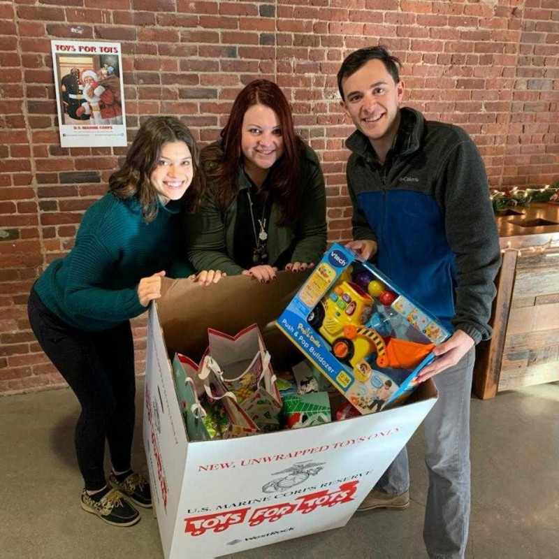 Picture of Markforged team members donating to Toys for Tots