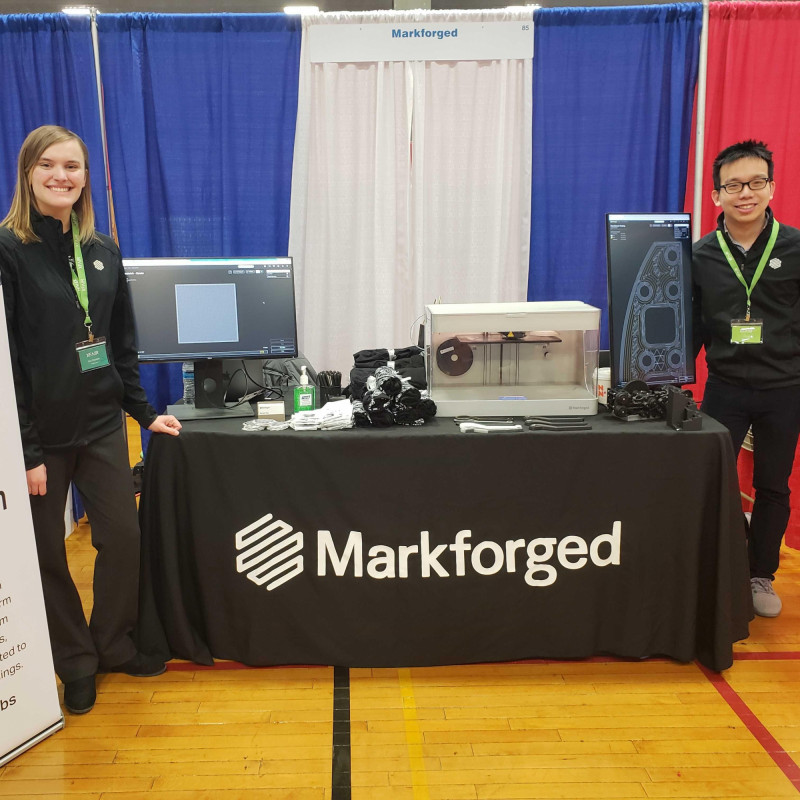 Picture of two Markforged engineers at a tradeshow event