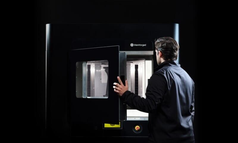 an engineer opens the door of the FX20 3d printer