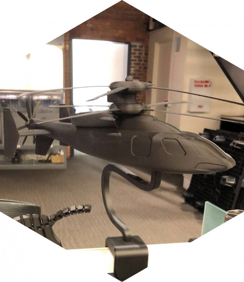 3D printed helicopter on an employees desk