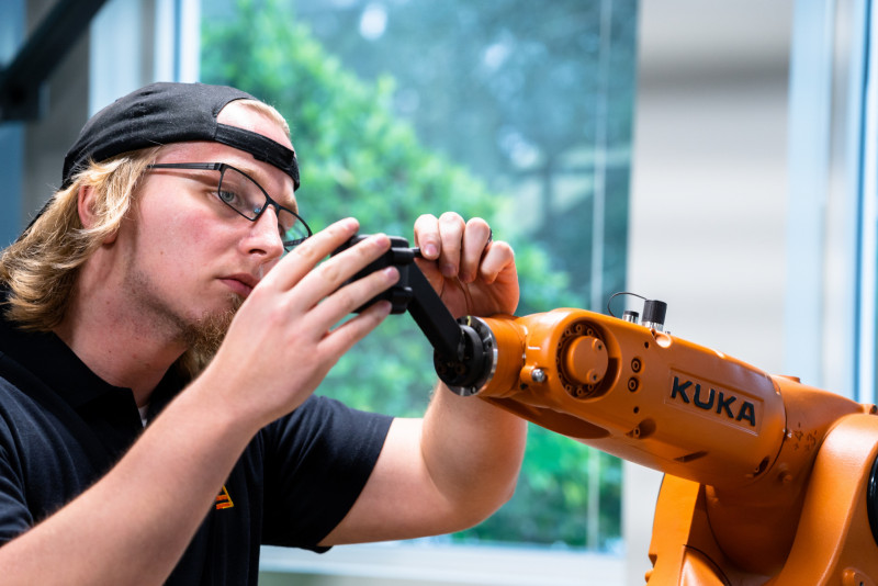 Engineer from Siemens Energy Innovation Center working on Kuka robot