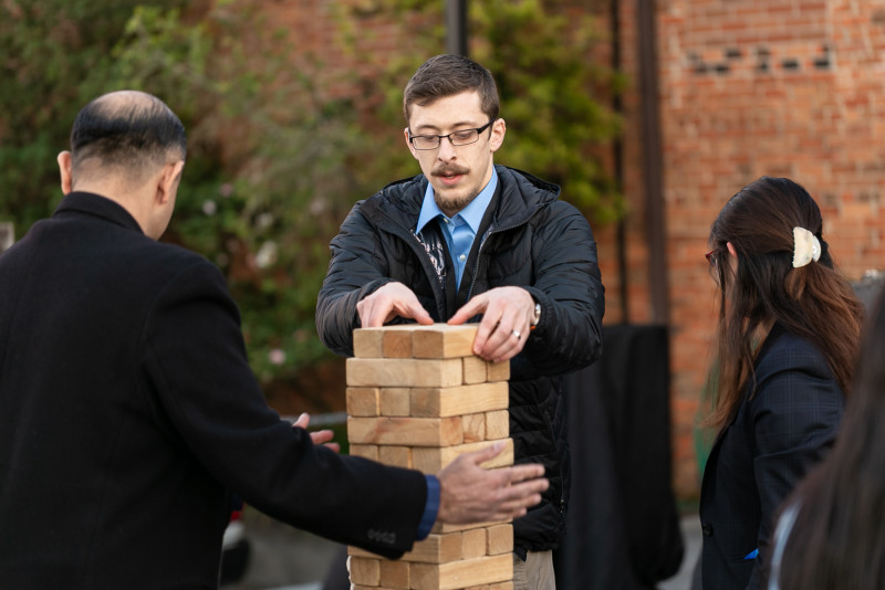 Picture of Markforged partners playing a giant Jenga game outside